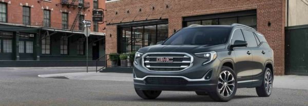The all-new 2018 GMC Terrain parked in front of a building