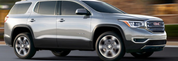 2018 GMC Acadia driving down the highway