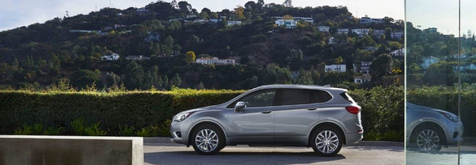 2020 buick envision parked at a house in the country side